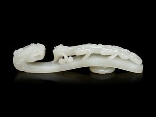 A Large and Finely Carved White Jade 'Chilong' Belt Hook Length 5 1/4 in., 13.3 cm