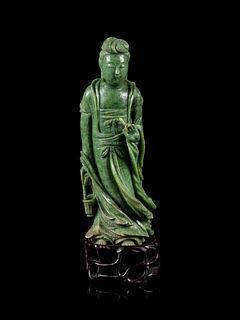 A Mottled Green Jade Figure of Guanyin Height 6 1/2 in., 16.51 cm.