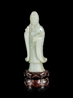 A Pale Celadon Jade Figure of Guanyin Height of figure 6 in., 15.24 cm.