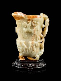A Russet and Pale Celadon Jade 'Chilong' Rhyton Cup Height 5 3/4 in., 14.6 cm.