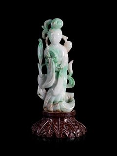 An Apple Green and White Jadeite Figure of a Lady Immortal Height 6 1/4 in., 15.8 cm.