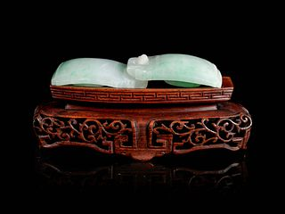 An Apple Green and Pale Celadon Jadeite Two-Part Belt Buckle Length 4 in., 10 cm.