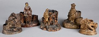 Five figural cigar/match holder and strikers