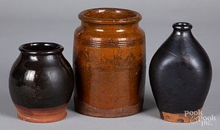 Two redware crocks and a bottle, 19th c.