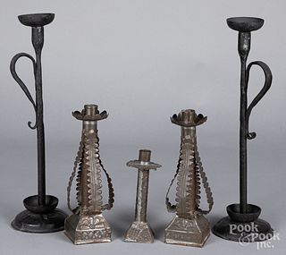 Pair of primitive iron candlesticks, etc.