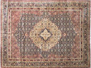 AN INDO PERSIAN TABRIZ POLYCHROME WOOL CARPET, 20TH CENTURY,