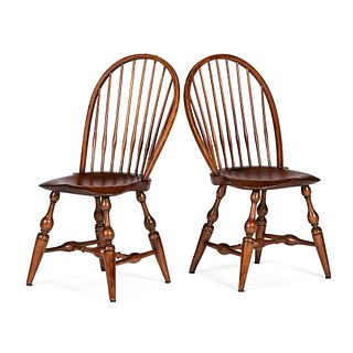 A Pair of Mixed Wood Sackback Windsor Chairs