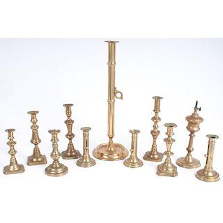 Ten Brass Candlesticks and One Oil Lamp