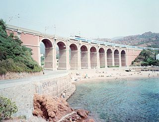 """Massimo Vitali (1944)  - Antheor Viaduct, from the portfolio """"Landscape with Figures"""", years 1980"""