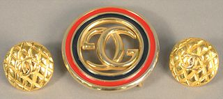 Three piece lot to include two Gucci belt buckles along with pair of earrings.