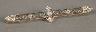 "14K gold and white gold bar pin set with eleven diamonds, lg. 2 1/2"", 5.5 gr."