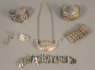 Group of sterling jewelry to include Georg Jensen pin, four bracelets, one large perfume necklace and bird pin.