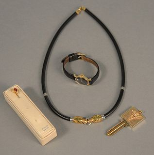 Four piece lot to include necklace with 18K gold ends, key with 14K gold top, 14K Omega ladies wristwatch and gold stick pin.