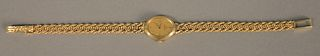 14K gold Omega ladies wristwatch, oval with 14K bracelet, total weight 18.7 gr.