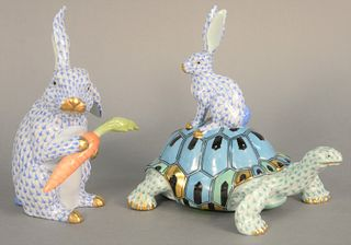 Two large Herend porcelain figures to include turtle with rabbit Kingdom classic 2004 along with rabbit holding a carrot, blue and green fishnet patte