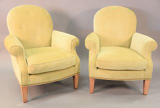 "Pair of contemporary light green upholstered arm chairs on square top legs, ht. 38"", wd. 33""."