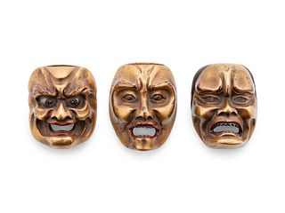 Three Gilt Lacquered Wood Mask Netsukes