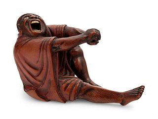 A Carved Wood Figure of Devil