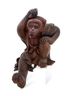 A Carved Wood Figure of a Monkey