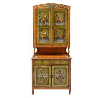 Sergio Bustamante. Gabinete. Firmado. A dos cuerpos. Elaborado en madera policromada. Con 2 cajones y 4 puertas. 197 x 89 x 49 cm