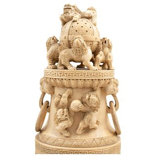 Urn. China, Ca .1900. Carved and inked ivory decorated with Foo dog figures, dragons on the handles and floral motifs.