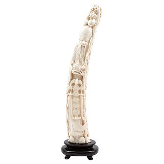 Figure of Elderly Man, China, 20th century, Carved and inked ivory on a wooden base.