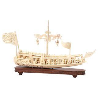 Ship. Asia, Ca. 1900. Openwork and carved ivory on a wooden base.