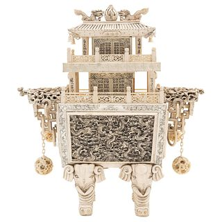 Temple, China, Early 20th century, Carved and inked ivory decorated with floral motifs, dragons and elephant-shaped legs.