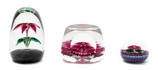 * A Group of Glass Paperweights Width of largest 3 1/4 inches.