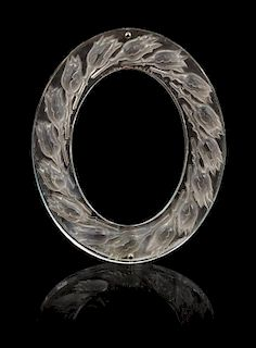 A Lalique Boutons De Roses Mirror Height 9 3/4 x width 7 3/4 inches.