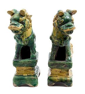 A Pair of Pottery Figures of Temple Lions Height 8 1/2 inches.