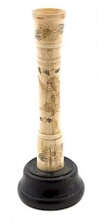 A Carved Bone Ornament Height overall 9 inches.