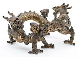 A Chinese Bronze Figural Stand Width 9 3/4 inches.