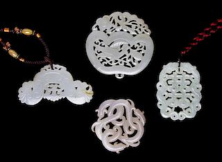 A Group of Four Jade and Hardstone Plaques Width of widest 3 3/8 inches.