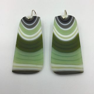 Carved glass earrings with silver plated ear wire