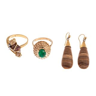 A Collection of Rings & Earrings in Gold