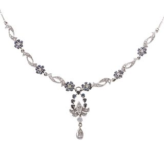 A Lady's Diamond & Sapphire Necklace in 14K