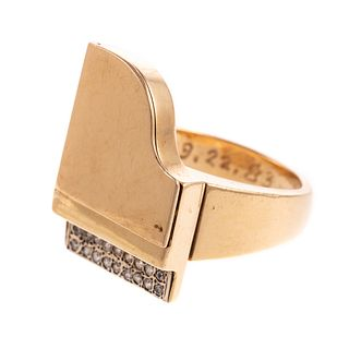 A Movable Piano Ring with Diamonds in 18K