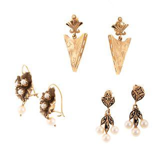 A Trio of Drop Earrings in 14K
