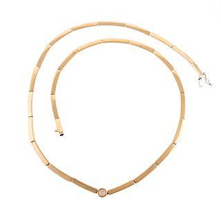 A 18K Contemporary Necklace with Diamond Center