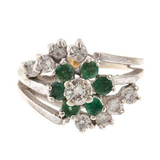 An Emerald & Diamond Cluster Ring in 14K