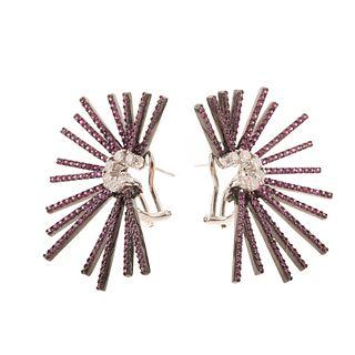 A Pair of Diamond & Ruby Starburst Earrings in 18K
