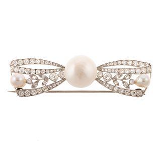 An Edwardian Diamond & Pearl Bow Brooch in Plat