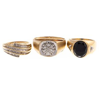 A Trio of Diamond & Black Onyx Rings in Gold