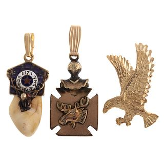 A Trio of Pendants in Gold