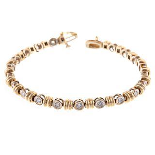 A Two Toned Diamond Line Bracelet in 14K