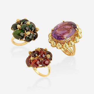 Three gold and gem-set rings