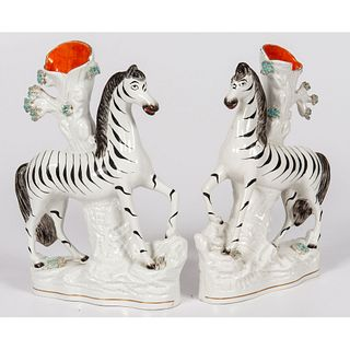 A Pair of Staffordshire Zebra Spill Vases