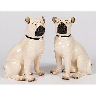 A Pair of Staffordshire Earthenware Pugs