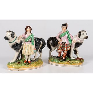A Pair of Staffordshire Royal Children with Newfoundland Dogs